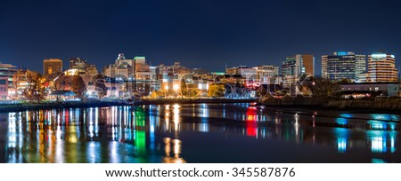 Wilmington skyline panorama reflected in Christiana River. Wilmington, the largest city in the state of Delaware, is built on the site of Fort Christina, the first Swedish settlement in North America - stock photo