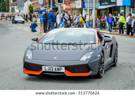 Wilmslow UK - July 9, 2013 : A Lamborghini  during the annual public gathering of local sports and super cars in affluent Wilmslow, Cheshire - stock photo