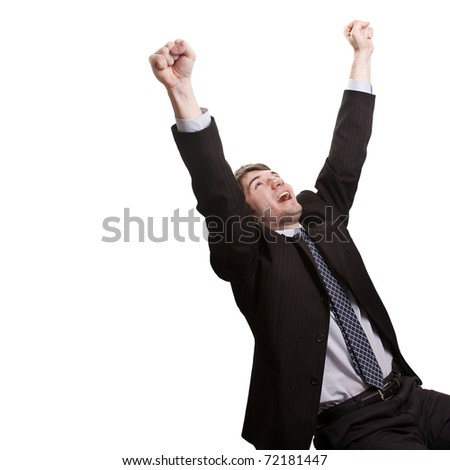 Win and success concept - victorious young businessman - stock photo