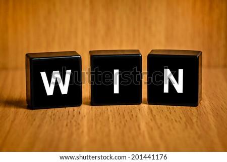 win text on black block - stock photo