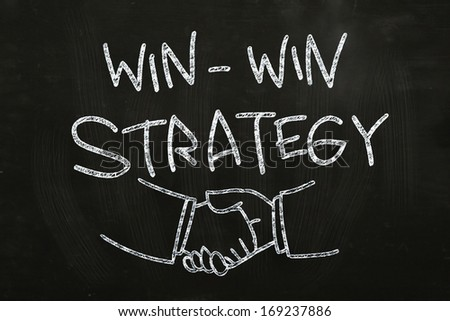 Win Win Strategy quotes and hand shakes, drawn with Chalk on Blackboard - stock photo