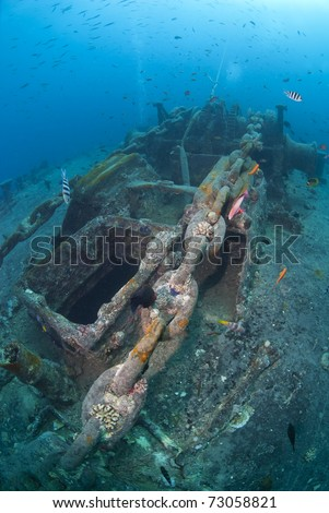 Winch and anchor chain of the SS Thistlegorm shipwreck. SS Thistlegorm, Straights of Gubal, Red Sea, Egypt. - stock photo