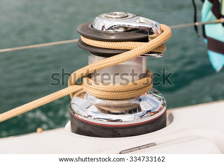 winch and ropes on a sailing boat