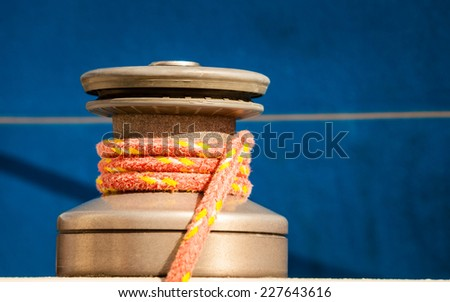 Winch capstan with rope on sailing boat. Yachting yacht in blue baltic sea sunny day summer vacation. Tourism luxury lifestyle. - stock photo