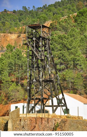 Winch of an old copper mine shaft. Detail of tower, Mining Museum. Riotinto, Huelva province, Andalucia, Spain. - stock photo