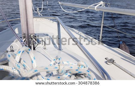 Winch with rope on sailing boat - stock photo