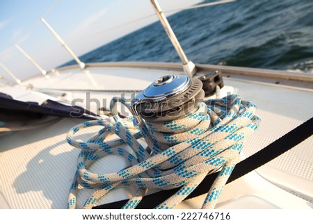 Winch with rope on the boat. capstan - stock photo