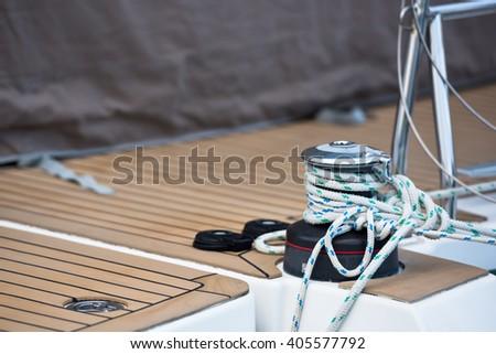 Winches and ropes, sailing yacht detail. Horizontal shot - stock photo