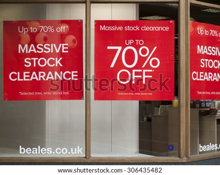 Winchester, High Street, Hampshire, England - August 15, 2015: Beales department store advertising new lines and sale, company established in 1881 founded by John Elmes - stock photo
