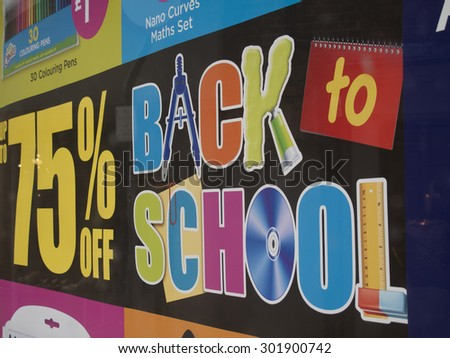 Winchester High Street Hampshire, England â?? July 31, 2015 â?? W H Smith shop window poster advertising reductions on back to school stationary - stock photo