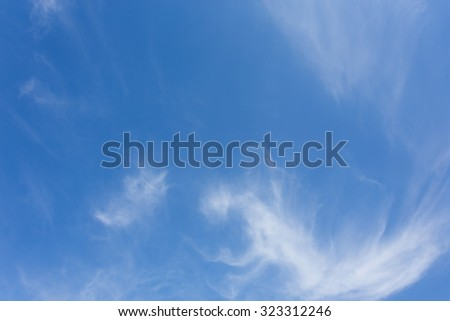 wind blowing cloud on clear blue sky background - stock photo