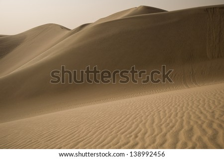 Wind-blown ripples in sand in the Qatari desert - stock photo