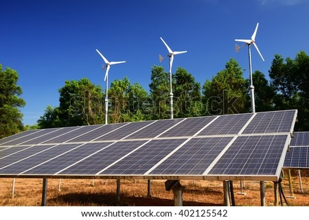 Wind energy and solar energy with blue sky - stock photo