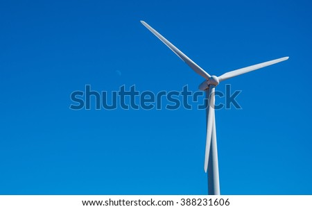 Wind Energy Blows into Future Amarillo and West Texas Wind Turbine Farms in the lone star state blue sky stock Wind Turbine Single Alone - stock photo