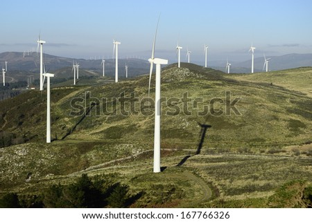 Wind energy business. Wind turbines in a mountain - stock photo