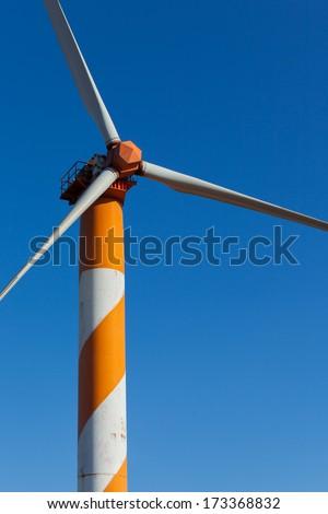 Wind Energy. Israeli wind turbine farm on Syrian border. Closeup of one wind generator. Golan Heights. - stock photo
