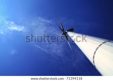 wind energy under blue sky - stock photo