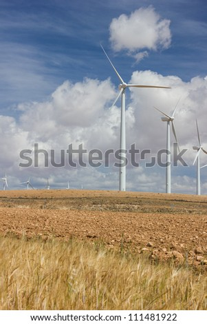 Wind Farm against cloudy sky