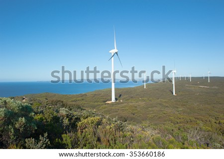 Wind farm along coast of Southern Ocean in Western Australia, supplying renewable energy to town of Albany, summer sunny blue sky, copy space. - stock photo