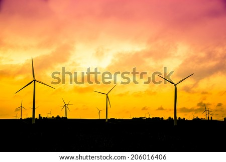 Wind farm at sunset, Alternative energy concept, instagram style retro processing. smart grid