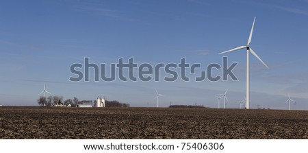 Wind farm at the farm,  turbines for miles in Minnesota. - stock photo