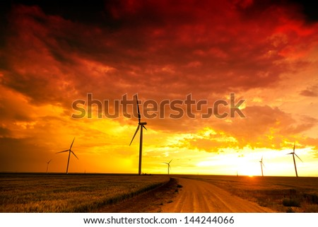 Wind farm at the sunset - stock photo