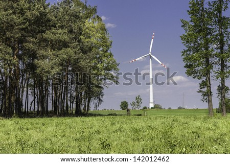 Wind farm by the forest - stock photo