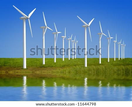 Wind farm  in grass over blue sky - stock photo