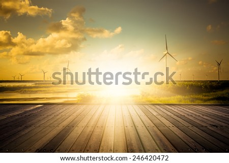 wind farm in the sunset, shanghai china. - stock photo
