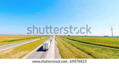 Wind farm near the highway - stock photo