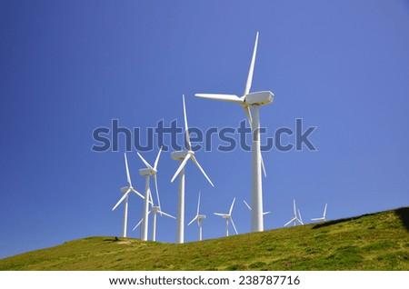 Wind farm on a green field - stock photo
