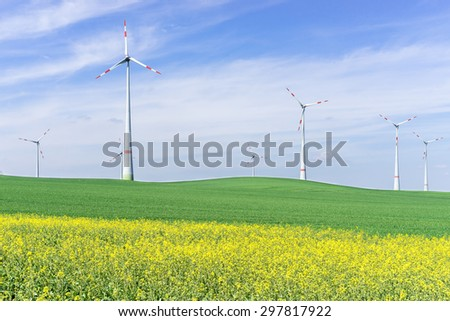 Wind farm on the field - stock photo