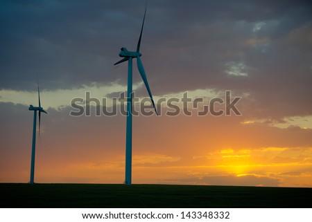 Wind farm on the plains at dusk - stock photo