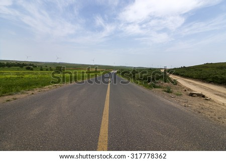 Wind farm road - stock photo