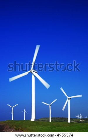 Wind farm with beautiful blue sky. More in my portfolio. - stock photo