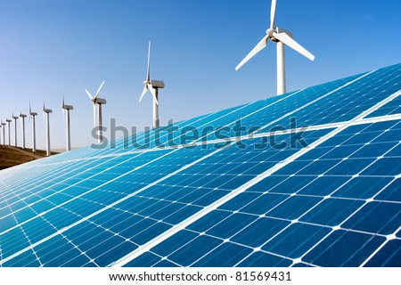 Wind generator and solar panel - stock photo