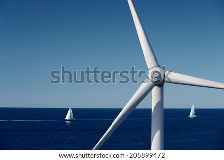 Wind generator turbine in the sea - stock photo