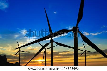 Wind Generator Turbines on Sunset - Green Renewable Energy - stock photo
