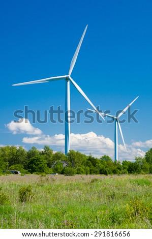 Wind generators in rural area. Renewable energy - stock photo