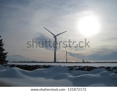 Wind generators of the electric power in the winter evening.