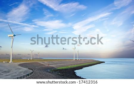 wind generators on coast - stock photo