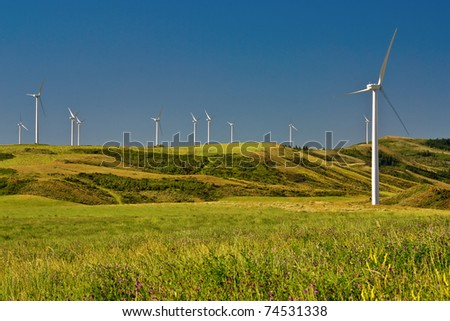 Wind Generators sit atop the hills collecting electricity from the wind