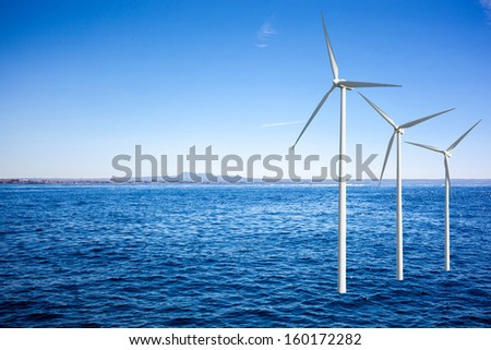 Wind generators turbines in the sea - stock photo