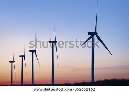 Wind mill farm at dusk. Global warming. Sustainable energy. Power - stock photo