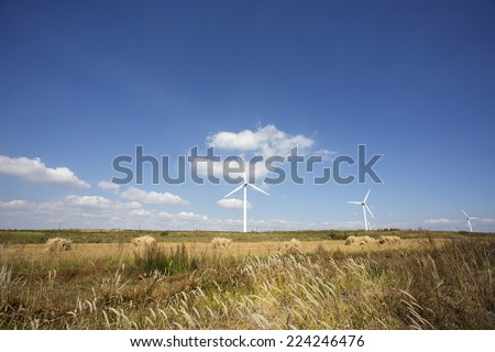 Wind mill  in autumn farm land,north China - stock photo