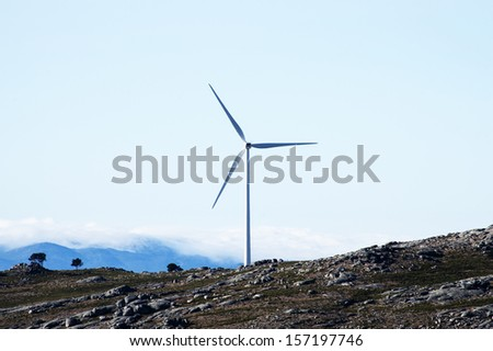Wind mill in the mountains generating energy / alternative energy / energy in Portugal - stock photo