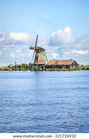 Wind mill of Zaanse Schans, a village in the Netherlands. - stock photo