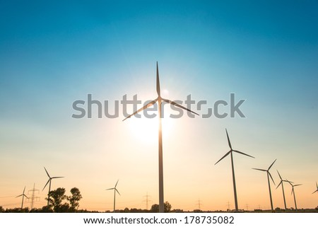 Wind mills during bright summer day - stock photo