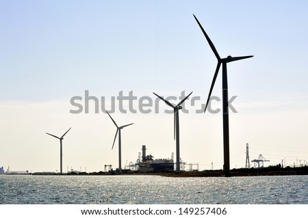 wind mills on the dimension of Fos-sur-Mer - stock photo