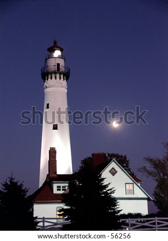 Wind Point Lighthouse near Racine, WI. Full moon rising in the background. - stock photo